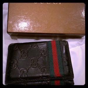 Men's Gucci black Embossed Leather wallet.